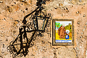 Beside many front doors you find tiles with representations from the life of the island saint Catalina Thomás, Valldemossa, Mallorca, Spain