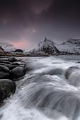 Dark clouds above snowy peaks and waves of the cold sea, Senja, Ersfjord, Troms county, Norway, Scandinavia, Europe
