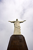 Low angle shot of the iconic statue of Christ the Redeemer on a cloudy day, Rio de Janeiro, Brazil, South America