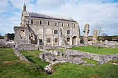 The grounds of the ruined Benedictine Priory of Binham Abbey founded in the 11th century, with the existing church behind, North Norfolk, England, United Kingdom, Europe