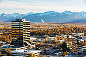 Aerial view of office buildings in midtown Anchorage during autumn with the Chugach Mountains in the background, Southcentral Alaska, USA
