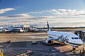 An Alaska Airlines 373 airplane parked at a gate at the Ted Stevens Anchorage International Airport, Anchorage, Southcentral Alaska, USA