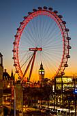 'Millennium Wheel and Big Ben framed at sunset; London, England'