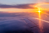 'Aerial view of a cloudy sunrise in winter from the passenger seat of a commercial airplane, Interior Alaska; Fairbanks, Alaska, United States of America'