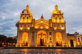 'Fully lit South American church and plaza at dusk; Cordoba, Argentina'