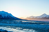 'Turnagain Arm just before sunrise on an icy winter morning along the Seward Highway; Alaska, United States of America'