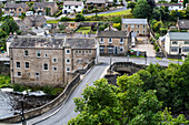 'A street crossing a river and residential buildings; Barnard Castle, Durham, England'