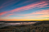 'Sunrise colour over the Frenchman River Valley in Grasslands National Park; Saskatchewan, Canada'