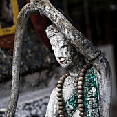 'Worn and weathered buddhist sculpture; Luang Prabang, Luang Prabang Province, Laos'