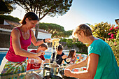 2 Families having Dinner at Poolside in a holiday home,  andalusia, southwest coast spain, atlantc, Europe