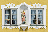 Two windows with statue of Virgin Mary, Bad Toelz, Upper Bavaria, Bavaria, Germany