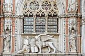 Doge kneeling in front of Lion of Venice, Porta della Carta, Doge's Palace, Venice, UNESCO World Heritage Site Venice, Venezia, Italy