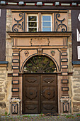 Historic wooden door in timbered house with ornamentation, Ziegenhain, Hesse, Germany, Europe
