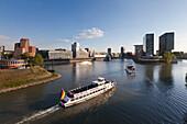 Excursion ships entering Medienhafen, Duesseldorf, North Rhine-Westphalia, Germany