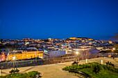 'View of the city of Lisbon from Miradouro de Sao Pedro de Alcantara at night; Lisbon, Portugal'