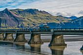 'Vehicle driving over a bridge along the south coast of Iceland; Iceland'