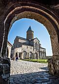 'View from the gate arch to the 11th century cathedral at the Alaverdi Monastery, Georgian Orthodox monastery in the Kakheti region of Eastern Georgia; Kakheti, Georgia'