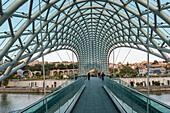 'Bridge of Peace, a pedestrian steel and glass bridge over the Kura River; Tbilisi, Kakheti, Georgia'