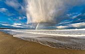 A rainbow in a storm cloud formation along the coast, South Shields, Tyne and Wear, England