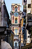 The tower of the cathedral seen from a alley of the Old Town, Sorrento, the Gulf of Naples, Campania, Italy
