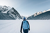Man walking on Lake Louise, Bow Valley, Banff National Park, Alberta, Kanada, north america