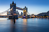 Tower Bridge and City of London skyline from Butler's Wharf at dusk, London, England, United Kingdom, Europe
