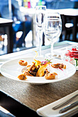 Gourmet seafood dish in restaurant