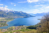View over Lake Como and villages framed by snowy peaks, Montemezzo, Alpe Zocca, Lombardy, Italian Lakes, Italy, Europe