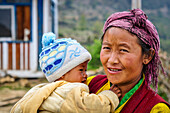 Mom holds her little son in her arms,Rasuwa district, Bagmati region,Nepal,Asia