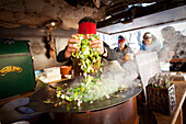 a snapshot taken during the preparation of a typical tyroler street food in the Christmas market, city of Bruneck, Bolzano province, South Tyrol, Trentino Alto Adige, Italy, Europe