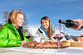 a snapshot during a lunch break out of a hut with good wine and typical food from Trentino, Trento province, Trentino Alto Adige, Italy, Europe