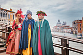 Europe, Italy, Veneto, Venice, Group of people in carnival fancy dress on the Accademia bridge