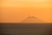 Stromboli, Messina district, Sicily, Italy, Europe, Eruption of the volcano Stromboli at sunset