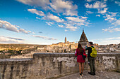 Tourists admire the ancient town and historical center called Sassi perched on rocks Matera Basilicata Italy Europe