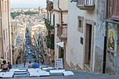 Tourists on flight of steps admire the old town and of Caltagirone province of Catania Sicily Italy Europe