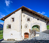 Panorama of typical alpine house framed by blue sky Guarda canton of Graubünden Inn District Lower Engadine Switzerland Europe