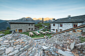 Mountain retreat and old stone caves called Crotto, San Romerio Alp, Brusio, Canton of Graubünden, Poschiavo valley, Switzerland