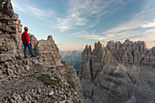 'Sesto/Sexten, Dolomites, South Tyrol, province of Bolzano, Italy, Climber on the via ferrata ''Path of Peace'' to the mountain of Monte Paterno'