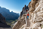 'Sesto / Sexten, province of Bolzano, Dolomites, South Tyrol, Italy, Climbers on the via ferrata ''Passaporto'' at the Mount Paterno'