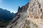 'Sesto / Sexten, province of Bolzano, Dolomites, South Tyrol, Italy, Climber on the via ferrata ''Passaporto'' at the Mount Paterno'