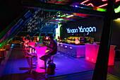 People relax at Yangon Yangon Rooftop bar at top of Sakura Tower at night, Yangon, Yangon, Myanmar