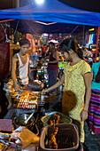 Satay barbecue at night market along Strand Road, Yangon, Yangon, Myanmar