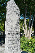 France, Paris 20th district. Pere Lachaise cemetery. The poet Guillaume Apollinaire's menhir grave (1880-1918) imagined by Pablo Picasso in 1924