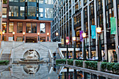 'Canada. Province of Quebec, Montreal. The international district. Place Victoria. Shopping mall '' Centre de commerce mondial ''. The fountain of Amphitrite and the granite pond'