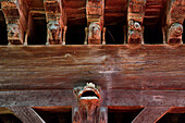 France, Ariege, figures carved on the wooden beams supporting medieval houses of Mirepoix