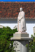 Portugal, Algarve. Faro. Dom Francisco Gomes statue, in front of the episcopal Palace.