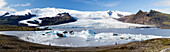 Panoramic view of tongue of the Vatnajokull Glacier creeping between mountains towards Fjallsarlon Lagoon, South Iceland, Polar Regions