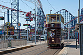 Traditional tram passing the Pleasure Beach, Blackpool, Lancashire, England, United Kingdom, Europe