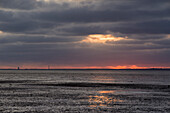 Sunset with rain clouds at the German North Sea and a view of Wangerooge, Wattenmeer National Park, Schillig, Wangerland, Landkreis Friesland, Lower Saxony, Germany