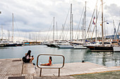 Tourists taking pictures with luxury yachts at the port of Mallorca. Puerto de Palma, Port of Palma, Palma, Mallorca, Spain, Europe